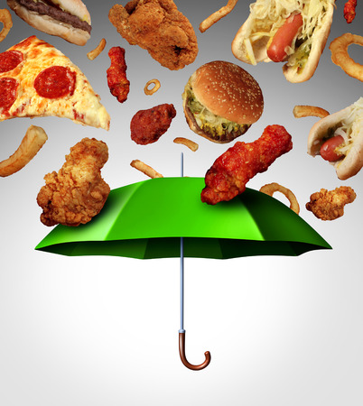 Bad diet protection food concept  with a group of greasy fatty fast food  falling down like rain and a green umbrella stopping the unhealthy food as a metaphor for poor nutrition and changing eating habits  photo