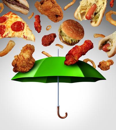 comida chatarra: Mal concepto de alimentos protecci�n dieta con un grupo de comida r�pida grasos, grasosos cayendo como la lluvia y un paraguas verde parando la comida poco saludable como una met�fora de la mala alimentaci�n y el cambio de los h�bitos alimentarios Foto de archivo