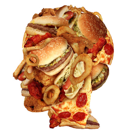 unhealthy: Unhealthy diet health concept with a group of greasy fast food in the shape of a human head as a symbol of dangerouse eating lifestyle and icon of addiction to  bad nutrition and risk of heart disease