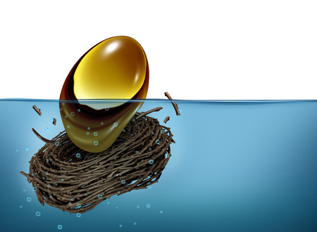 Nest Egg crisis financial concept as a golden oval and nesting bird twigs falling into water photo