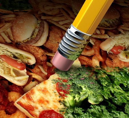 erased: image of greasy fat fast food being erased by a pencil revealing underlying healthy green vegetables Stock Photo