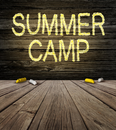 camping: Summer camp sign with a drawing�on a natural rustic wooden wall from a country cabin outdoors as a symbol of recreation and fun education with a group of chalk as a metaphor for arts and crafts learning success