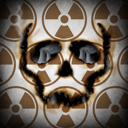Radiation concept and nuclear power plant risk metaphor as a human skull face icon burning a radioactive hole exposing atomic reactors  Stockfoto