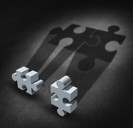 financial metaphor: Visi�n Partnership concepto de negocio como dos piezas de un rompecabezas sombras que llevan los s�mbolos juntos como un equipo unido como una met�fora financiera para acuerdo de asociaci�n y trabajar juntos en el futuro para el �xito Foto de archivo