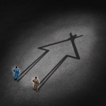 merge: Team success and partnership cooperation for a successful winning strategy as a business concept with two businessmen casting a shadow that is in the shape of an upward arrow with a victory gesture