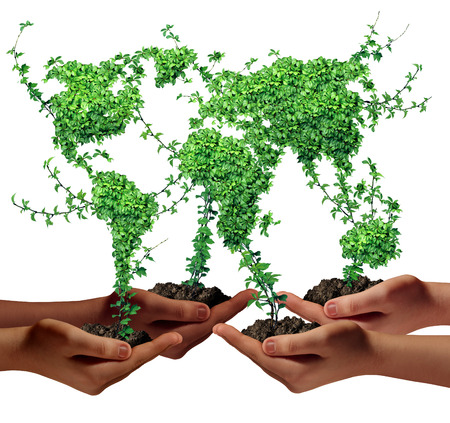 Environment community and business development concept as a group of global ethnic people hands holding green plants with leaves shaped as the world as a metaphor for a growing international economy  photo