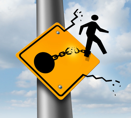 Escaping to freedom business concept as a businessman symbol on a traffic sign breaking free from the restrains of a ball and chain as a success metaphor of a new career or conquering adversity and emotional stress