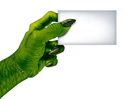 monster movie: Zombie hand holding a blank card sign on a side view as a creepy halloween or scary symbol with textured green skin wrinkled monster fingers and stitches isolated on a white background   Stock Photo