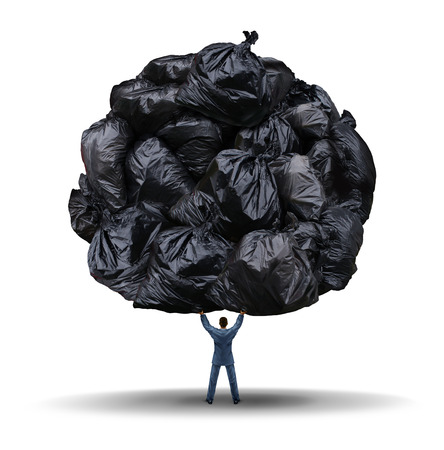 clutter: Clutter management business concept as a businessman lifting up a group of garbage bags as a leadership metaphor for cleaning up corporate waste and cutting company fat or getting rid of exess  Stock Photo