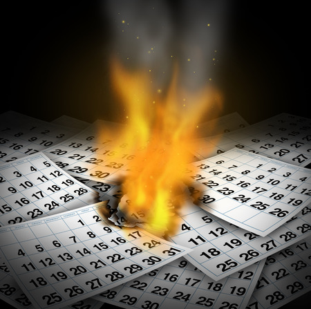 losing memories: Wasting time concept and business deadline stress as burning calendar pages with flames rising as a loss metaphor for inefficient lazy schedule management crisis or losing memories  Stock Photo