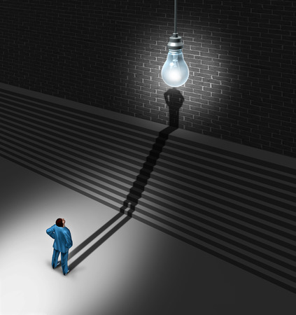 shadow: Brainstorming businessman concept as a man standing in front of upward stairs with his shadow going up the sairway to merge with an illuminated lightbulb over the head as a creative success metaphor for innovation achievement