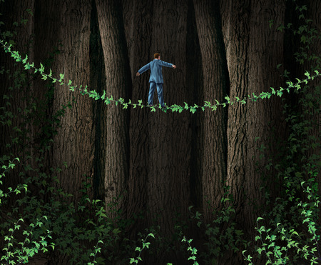 reducing: Green Technology Investing business concept as environmentally friendly companies supporting clean solutions for profit as a businessman walking through a dense forest on a tightrope made from a vine as a metaphor for reducing environmental imact and sust Stock Photo
