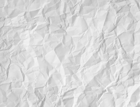 white textured paper: Wrinkled white paper textured background as a crumpled crushed sheet with a rough three dimensional surface as a design element document for copy spave