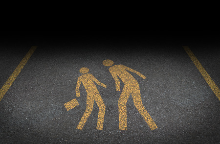 Big bully and bullying concept as yellow painted road sign on asphalt with an abusive bully attacking a another person as a symbol of the anxiety of being bullied and the social issues of human psychological abuse and fear  photo