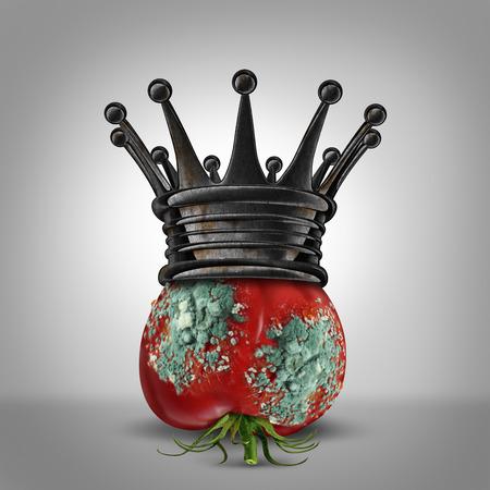 Concepto de liderazgo Corrupción como un tomate roten con el molde que lleva una corona del rey oxidado como una metáfora de negocios para un líder corrupto o opresor lentamente pudriendo