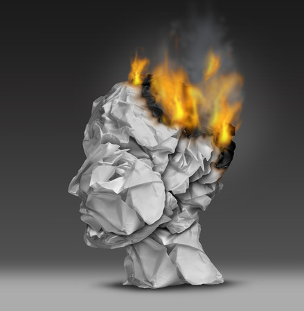 burned out: Headache  and mental illness concept as a group of crumpled office paper shaped as a human head that is on fire burning away at the brain as a symbol and medical metaphor for emotional stress at work or degenerative dementia disease as alzheimers  Stock Photo