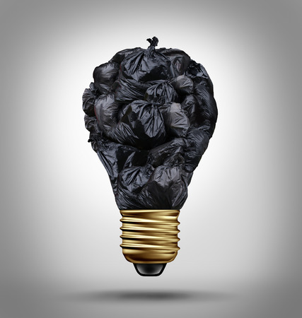 Garbage management solutions concept with a group of black trash bags shaped as a light bulb as a symbol and icon of environmental damage and recycling waste issues