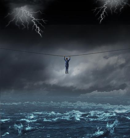 Het overleven van de storm business concept met een zakenman opknoping op een koord oversteken gevaarlijk water als een concept en metafoor voor het veroveren van tegenspoed en het overwinnen van uitdagingen Stockfoto