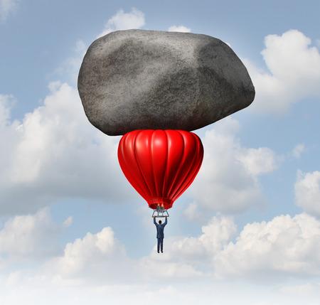 obstaculo: El liderazgo y el poder empresarial desafía concepto como un hombre de negocios pilotar un globo de aire caliente de color rojo con una enorme roca pesada frenar el alza como un obstáculo para la carrera y el éxito financiero