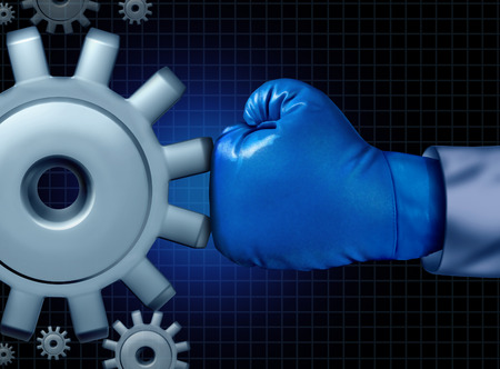 Business fight conflict concept with a blue boxing glove confronting and challenging a giant mechanical gear as a concept for financial competition and career battle to conquer and be successful against adversity