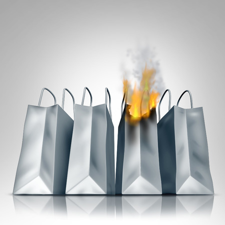budget crisis: Losing sales business crisis concept with a group of shopping bags as one bag burns in flames as a financial symbol of market loss and debt problems due to budget problems  Stock Photo