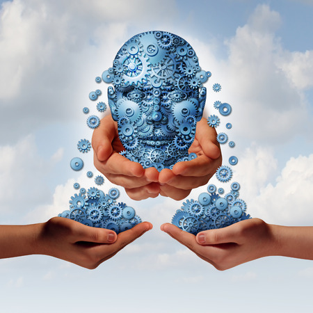 Success tools busiiness concept as a group of gearsand cogs shaped as a human head giving and sharing financial and industry information to partners with their hands open as a metaphor for training and skills education  photo