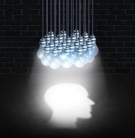 brain function: Thinking group and team work creativity concept as a bunch of lightbulbs working together shinning down light shaped as a human head for a symbol and icon of creative cooperation or mental health brain function idea