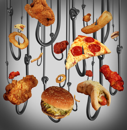 Eating addiction health care concept with a group of metal fish hooks using fast food as human bait as fried chicken hamburgers and french fries as a symbol of the dangers of being hooked on sugar fat and salt