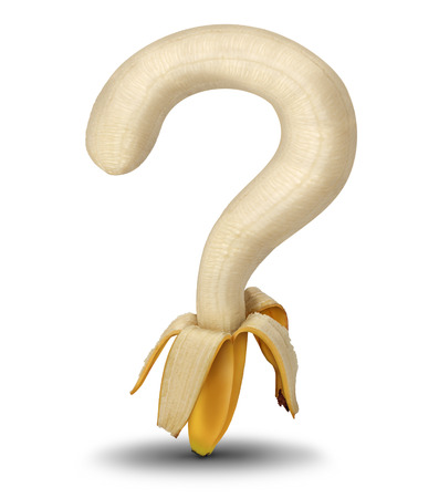 eating questions: Nutrition questions and choosing healthy food options at the grocery store or market with aan open peeled banana shaped as a question mark as a symbol for diet guidance and eating habits on a white background  Stock Photo
