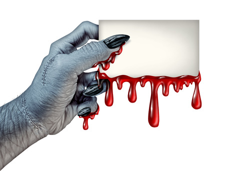 Zombie monster hand holding a blank blood dripping card sign on a side view as a creepy halloween or scary symbol with textured white skin wrinkled monster fingers and stitches isolated on a white background