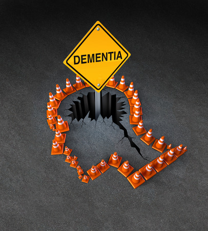 Dementia handicap concept as a group of three dimensional traffic cones shaped as a human head with a warning road sign emerging out of  a hole in the street in the shape of a brain as a symbol of neurological problems  photo
