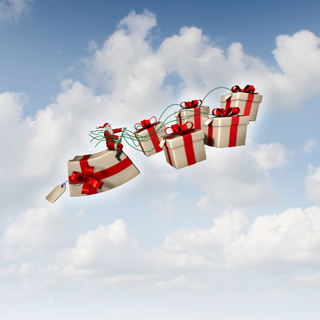 Christmas gift sled or santa sleigh concept as Santaclause riding a group of three dimensional presents with holiday silk ribbons as a traditional symbol of winter gift giving and seasonal festive icon for delivering joy to good boys and girls. photo
