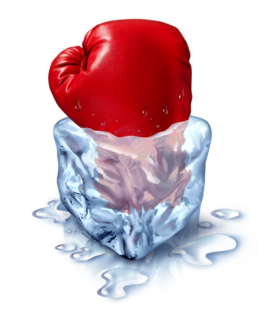 financial assets: Freezing out the competition business concept as a red boxing glove in an ice cube as a metaphor for chilling out with a fresh competitor icon or frozen financial assets. Stock Photo