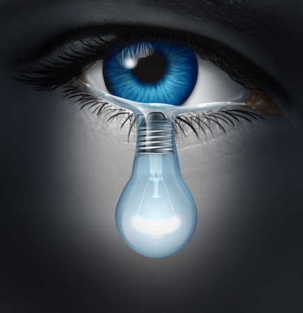 sad eyes: Depression therapy concept as a depressed human eye crying a tear shaped as a light bulb as a metaphor for solutions in the the treatment of mental health issues through psychotherapy or medication healing. Stock Photo