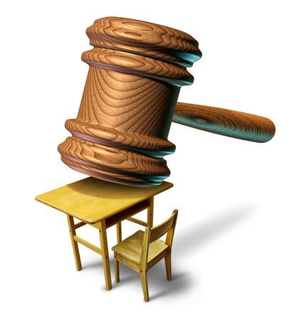 law school: Education law and school justice with a judge mallet or judges wooden gavel on a student class desk as a metaphor for public safety teacher or student abuse with a legal lawyer or attorney guidance for curriculum and learning issues