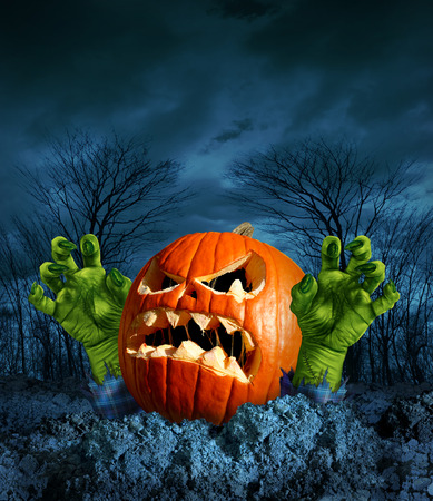 scary night: Zombie pumpkin halloween greeting card with copyspace as a scary surprise creepy jack o lantern with monster green hands rising from the dead on a dark cold haunted autumn night  Stock Photo