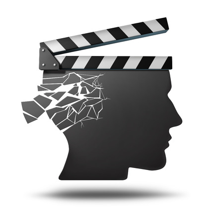 losing memory: Dementia memory loss as a movie director clapboard shaped as a human head with cracks falling apart as a metaphor for a medical brain problems and losing memories  Stock Photo