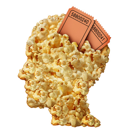 ticket stubs: Thinking movies concept and movie guide or reviews symbol as a heap of popcorn shaped as a human head with ticket stubs emerging as an icon for entertainment issues and public media consumption