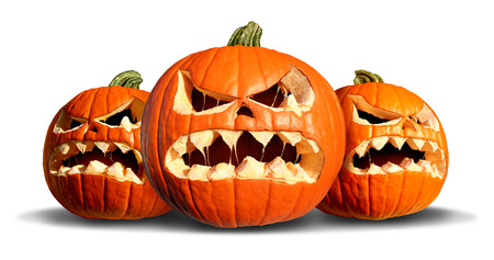 Pumpkin monster group with three scary pumpkins on a white background as a concept  and symbol for a creepy advertisement and marketing announcement for a harvest time party. photo