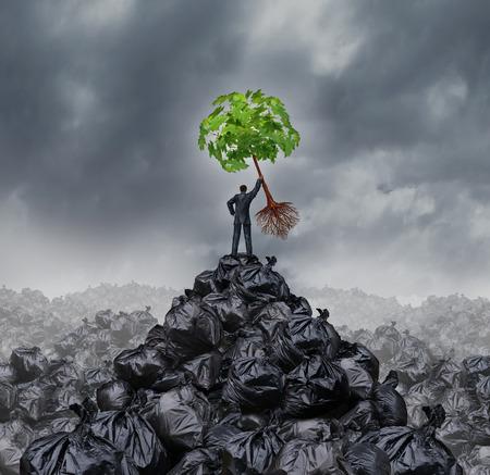 reciclar basura: Concepto empresario Verde como un hombre en la parte superior de un montón montaña de basura hasta la celebración de un árbol de hoja verde con las raíces como un entorno y un icono de conservación para la gestión de residuos o un nuevo comienzo saludable. Foto de archivo