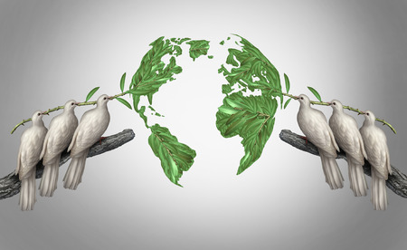 world peace: Global relations concept as a group of white peace doves holding olive branches coming together from the east and west to form a world map as a symbol for peace talks between nations. Stock Photo