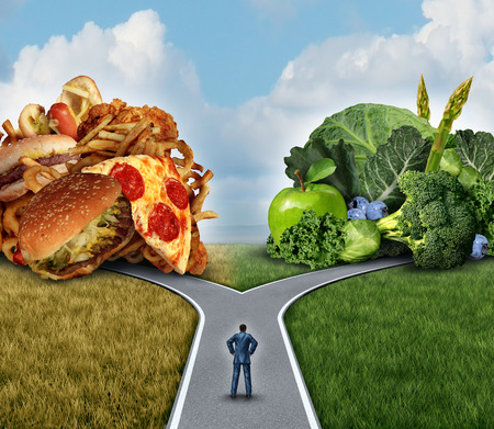 challenging: Diet decision concept and nutrition choices dilemma between healthy good fresh fruit and vegetables or greasy cholesterol rich fast food with a man on a crossroad trying to decide what to eat for the best lifestyle choice. Stock Photo
