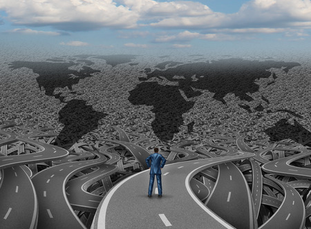 Global direction and world businessman road concept as a group of tangled highways with a confused man standing on a path to success as a business and economy metaphor for international strategy and planning.