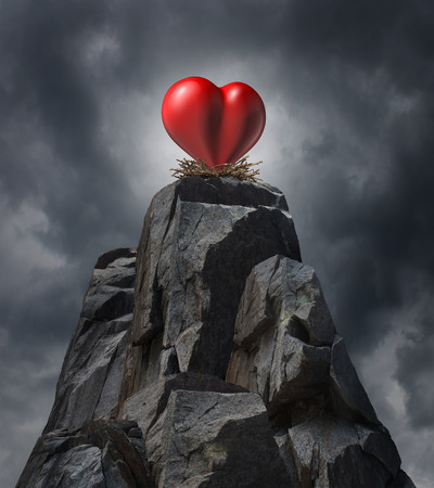 challenging sex: Love and relatinship challenge problem concept and romantic life trouble or heartache and loneliness as a red heart  sitting high on cliff in a nest as a long distance dating symbol or finding romance. Stock Photo