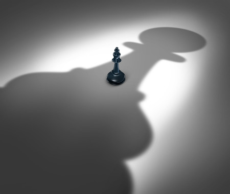 power giant: Management change and new leadership concept or changing a manager in the future as a symbol with a chess king facing a giant cast shadow of a pawn as an icon of  upcoming business power.