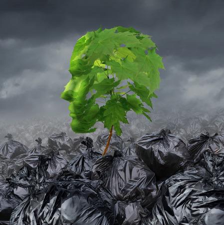 Revalidatie-concept en rehabiliteren een lijdende patiënt medische en geestelijke gezondheidszorg symbool doormaakt afkickkliniek voor drugs misbruik of emotionele schade als een jong boompje boom met groene bladeren in de vorm van een menselijk hoofd groeit uit van een hoop van vuilniszakken.