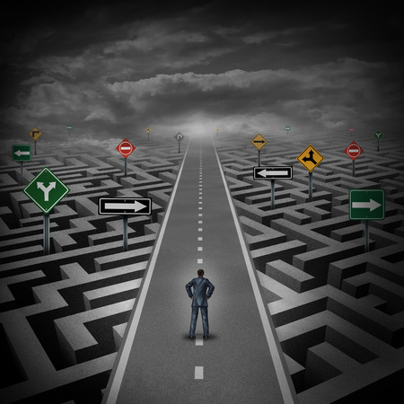 Crisis solution concept as a businessman standing on a straight road through a maze or labyrinth with confusing direction road signs as a metaphor. Stock Photo