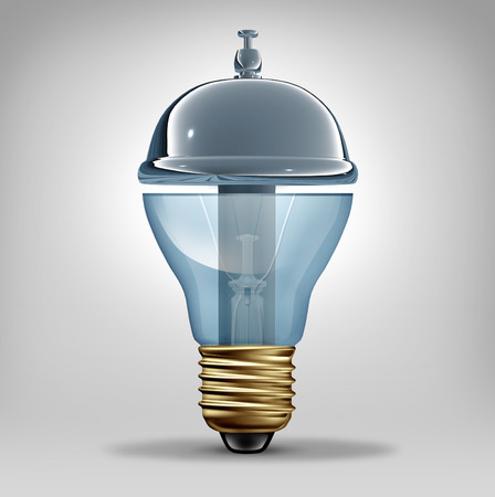 Creative services concept as a three dimensional lightbulb shaped as a customer hospitality service bell as a business symbol for providing innovative ideas and art direction communication photo