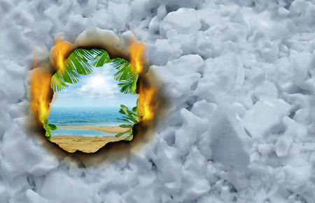 Winter escape concept as a burning hole on a cold winter snow background revealing a hot tropical beach and ocean scene  as a traval and vacation symbol. photo