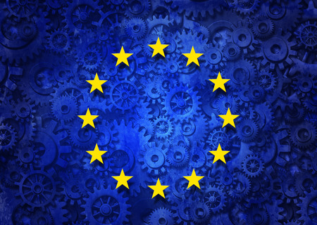 European business concept as a group of machine gears with the flag of europe as a concept for the economy and a financial system icon. Foto de archivo
